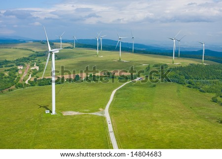 Wind power farm installation in sunny day - stock photo