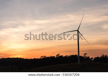 Wind power generation,Wind turbines on farmland and agricultural countryside with sonrise