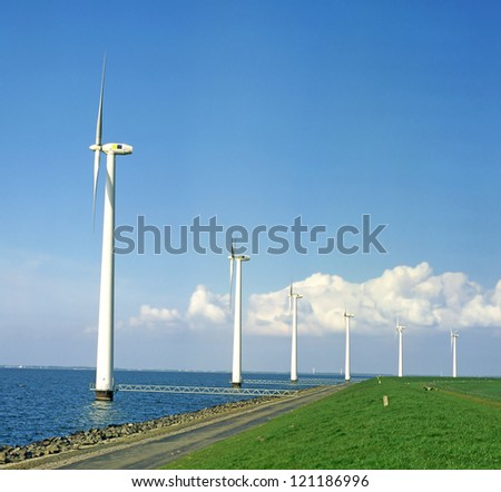 Wind power in the sea, The Netherlands - wind turbine, eco-power - stock photo