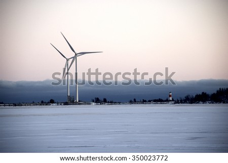 Wind power plants by the sea in winter