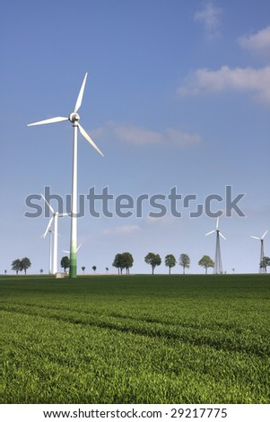 wind power plants on nice spring day - stock photo