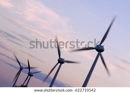 Wind power stations at sunset