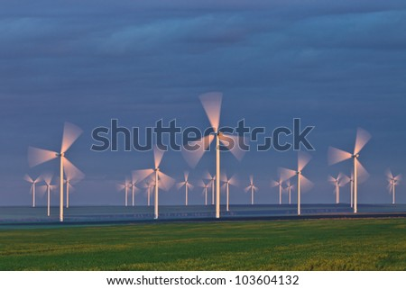 wind power turbines on a hill in morning - stock photo