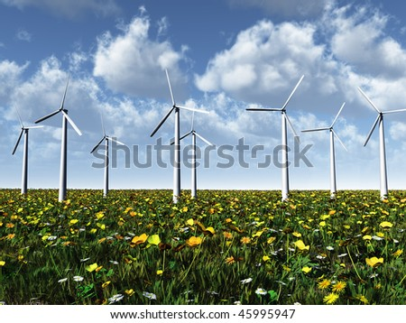 Wind power turbines on a summer meadow on a beautiful sunny day.