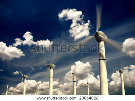 Wind power turbines with sky background - stock photo