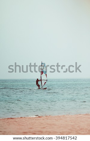 Wind surfing man's photo toned in vintage style - stock photo
