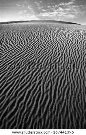 Wind swept sand creating ridges on a Death Valley sand dune in California - stock photo
