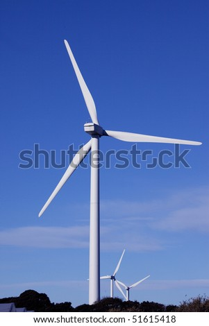 Wind turbine against a blue sky