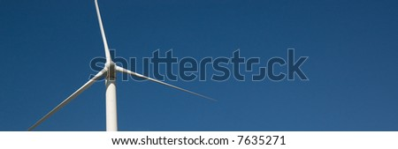Wind turbine against a blue sky background - stock photo