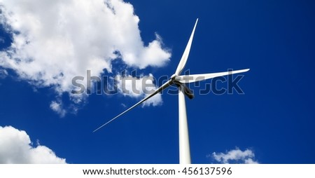 wind turbine against blue sky