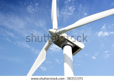 wind turbine against blue sky close up - stock photo