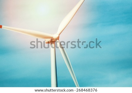 Wind turbine against deep blue sky - - stock photo