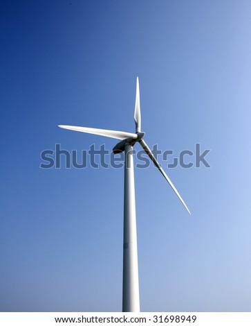 Wind turbine and deep blue sky - stock photo