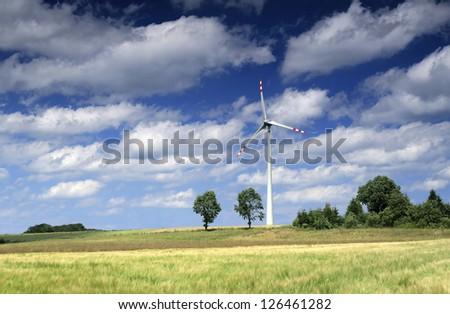 Wind turbine and fields - stock photo