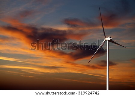 Wind turbine and sunset multicolor sky