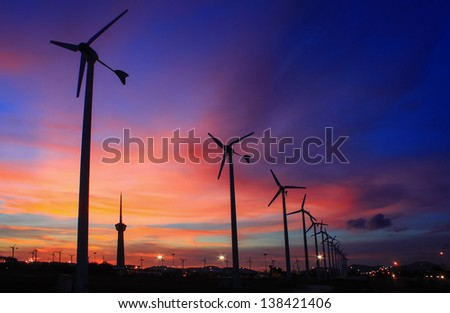 wind turbine array silhouettes - stock photo