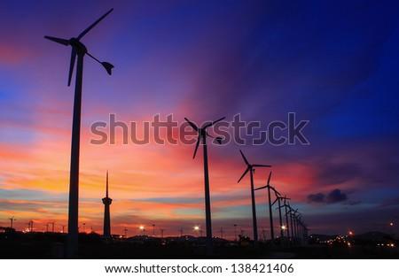 wind turbine array silhouettes - stock photo