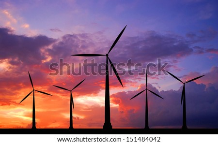 wind turbine at sunset background ecosystem for design - stock photo