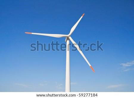 Wind turbine blade at blue sky. - stock photo