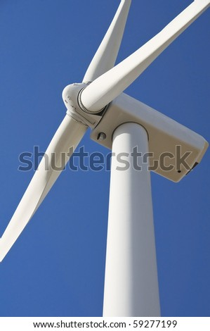 Wind turbine blade at blue sky.
