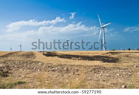 Wind turbine blades in countryside. - stock photo