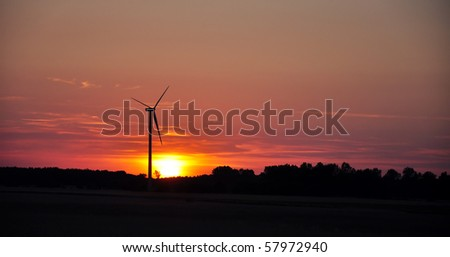 wind turbine during sunset in summer time - stock photo