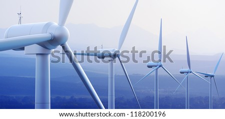 Wind turbine farm against distant mountains (3d graphic) - stock photo