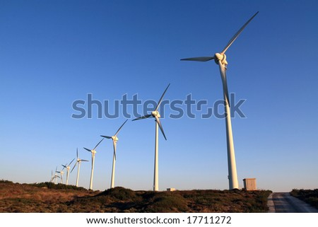 wind turbine farm at the sunset - stock photo