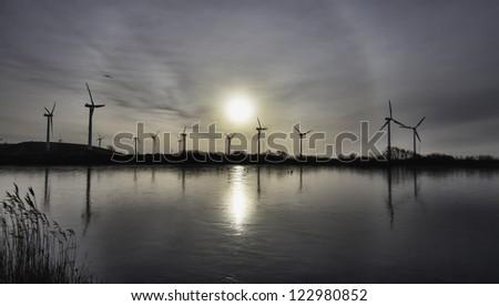 Wind turbine farm in the wadden sea, Esbjerg, Denmark - stock photo