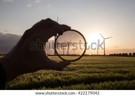 wind turbine farm sundown foto filter - stock photo