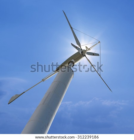 wind turbine for renewable energy with beautiful sunlight background