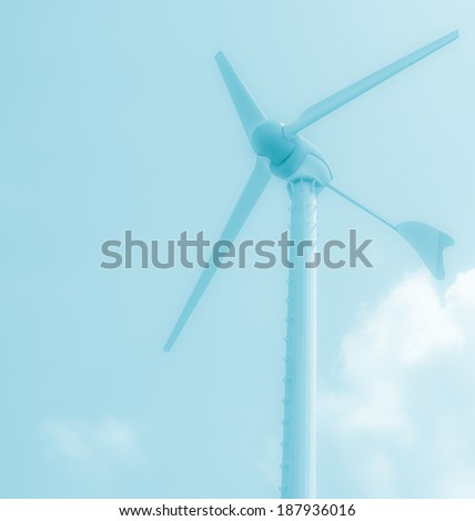 Wind turbine generating electricity soft focus with blue  tone