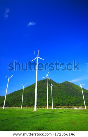 Wind turbine generator electricity with blue sky.