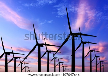 wind turbine generator with twilight sky on background - stock photo