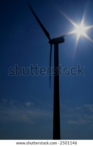 Wind turbine in contre-jour with sun in back side, lens flare