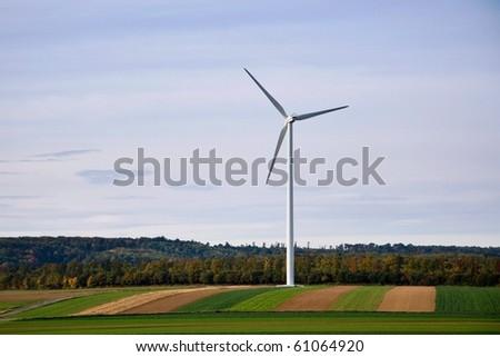 Wind turbine in countryside - stock photo