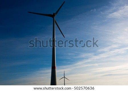 Wind turbine in germany over blue sky