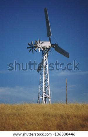 Wind turbine in grassland (slight grain) - stock photo