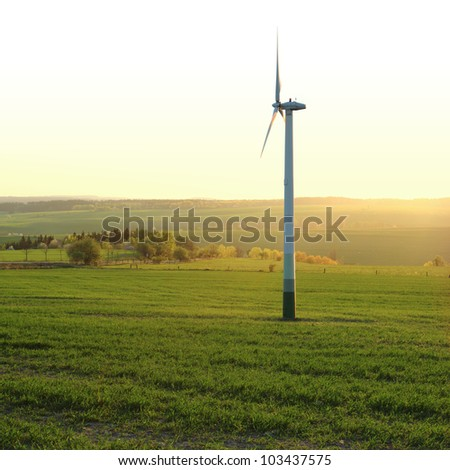 Wind turbine in the field - square composition
