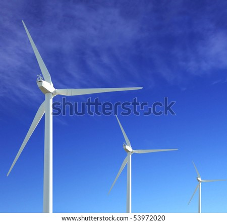 wind turbine iwith blue sky as background - stock photo
