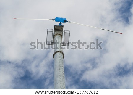 wind turbine on a cloudy day - stock photo