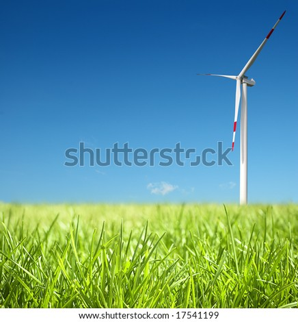 Wind turbine on a field - stock photo