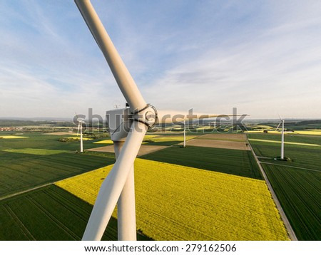 Wind turbine on a field, aerial photo - stock photo