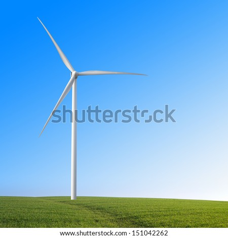 wind turbine on a green field - stock photo