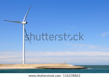 Wind turbine on coast - stock photo