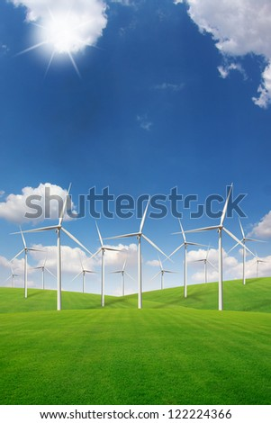 Wind turbine on green grass field
