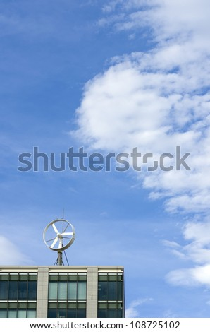 wind turbine on the building roof - stock photo
