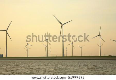 Wind turbine on the German island in the North Sea.  Early morning, sunrise. - stock photo
