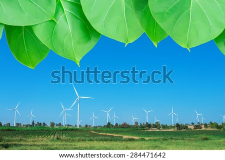 wind turbine power generator with green leave. concept for green power. - stock photo
