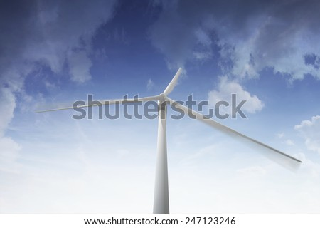 Wind turbine rotating - stock photo